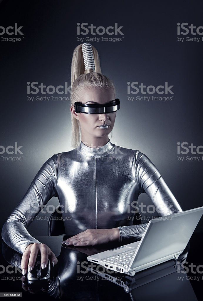 Beautiful cyber woman working on her laptop royalty-free stock photo