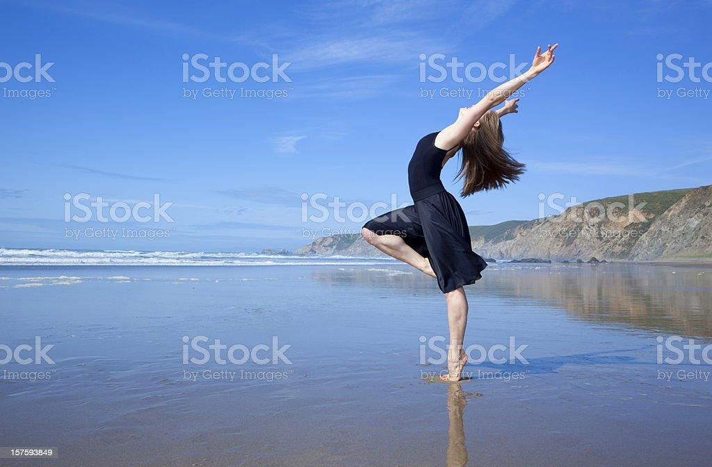 beautiful dancer at the beach stock photo