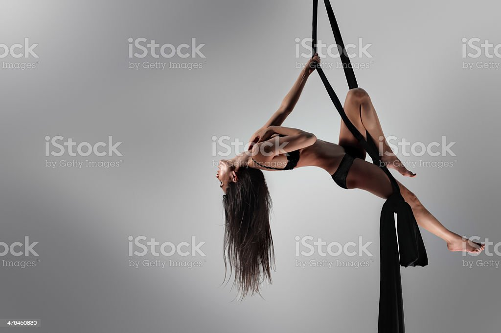Beautiful dancer on aerial silk, fabric stock photo