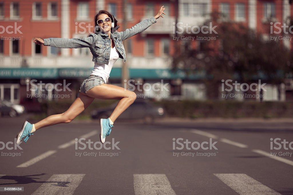 Beautiful dancing girl on a street stock photo