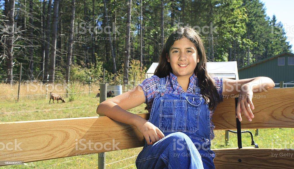 beautiful dark girl, open wagon on farm - happy, relaxed stock photo
