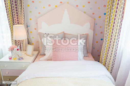 istock A beautiful daughter bedroom with a pink pillow and pink bed with sweet wall. 937224684