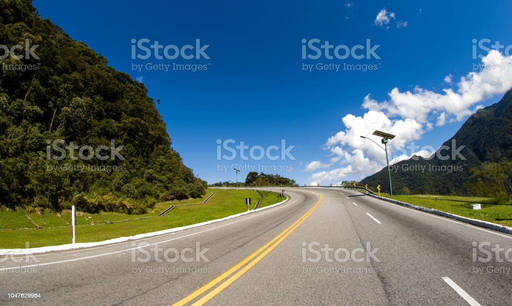 Beautiful day, blue sky and road trip stock photo