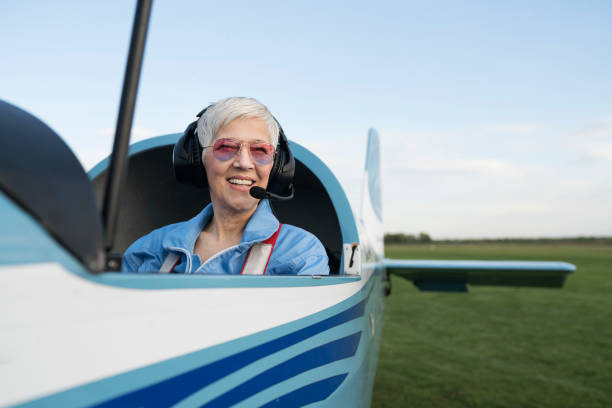 Beautiful day for flying Woman pilot, preparing for flying pilot stock pictures, royalty-free photos & images