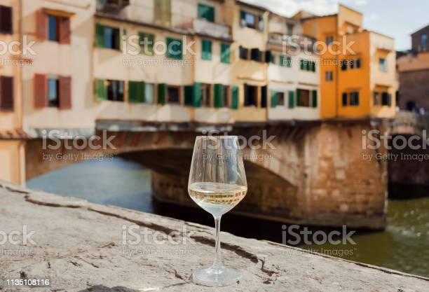 Beautiful day of traveler with wine glass near river banks in italy picture id1135108116?b=1&k=6&m=1135108116&s=612x612&h=30s4rpytg3iwom  sfc hckgsqxiqaiya  7txusa2k=