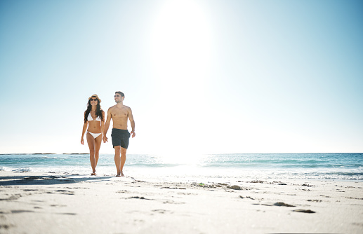 Shot of a young couple going for a walk along the beachhttp://195.154.178.81/DATA/i_collage/pu/shoots/805663.jpg