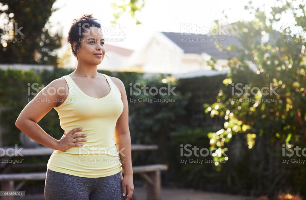 Beautiful days like these just motivate her to workout stock photo