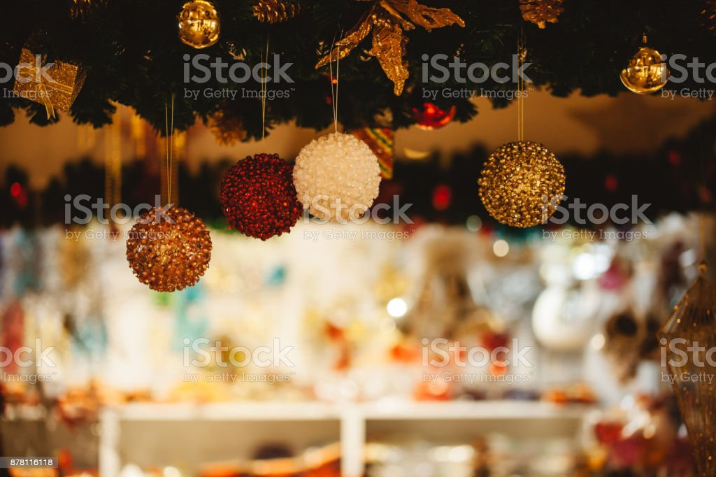 Beautiful decorated Christmas tree background with bauble and xmas ornaments blurred in bokeh home stock photo