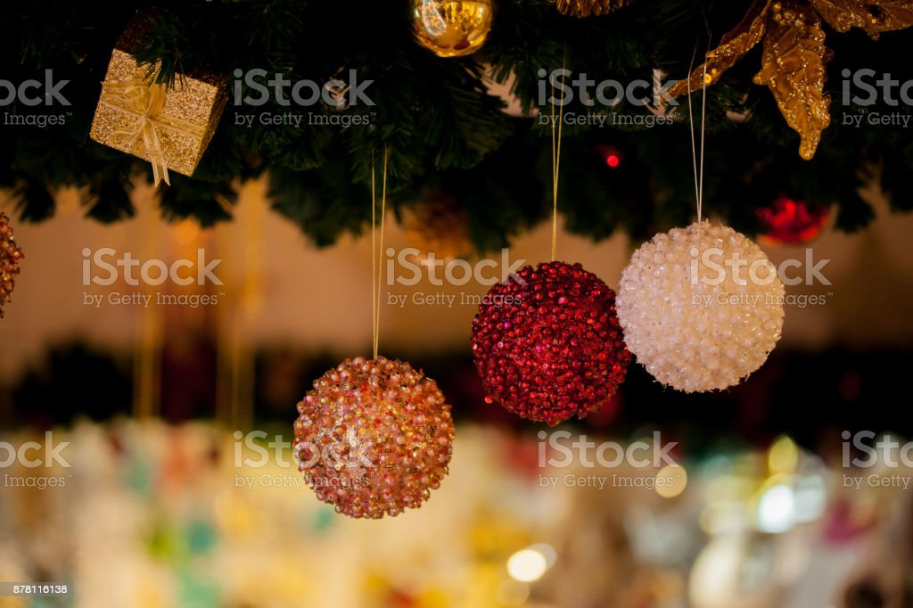 Beautiful decorated Christmas tree background with bauble and xmas ornaments blurred in bokeh home. stock photo