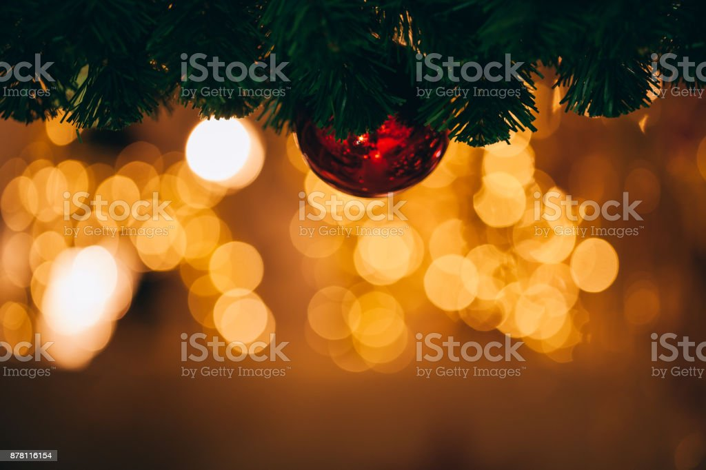 Beautiful decorated Christmas tree background with bauble and xmas ornaments blurred in gold bokeh. stock photo