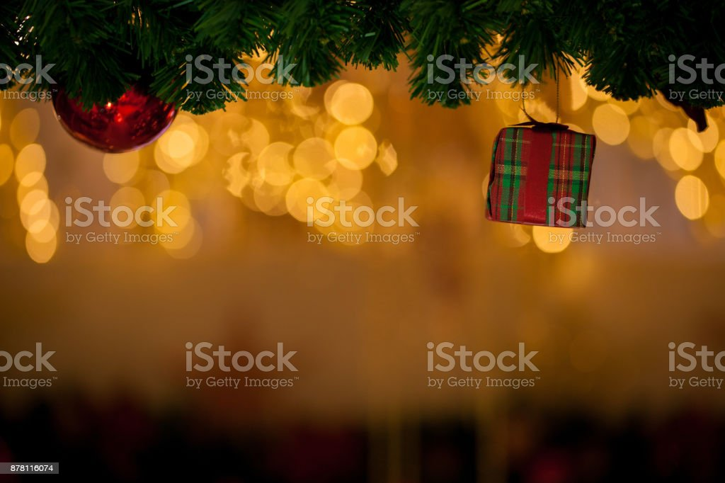 Beautiful decorated Christmas tree background with red gift box and xmas ornaments stock photo