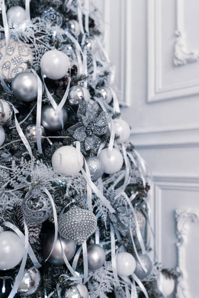 Beautiful decorated Christmas tree in white and silver colors stock photo