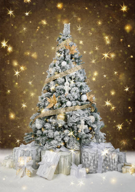 Beautiful decorated christmas tree with present boxes in white and gold colors stock photo