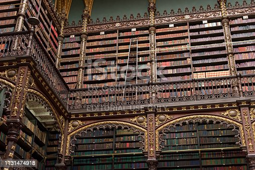 istock Beautiful Decorated Shelves Full of Antique Books 1131474918
