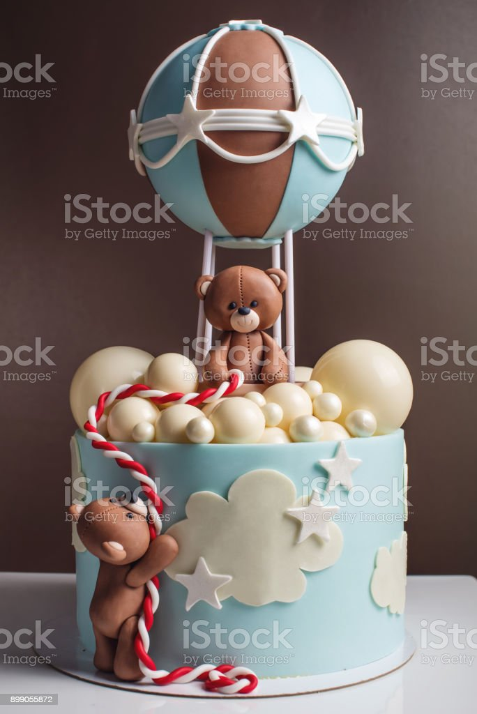 Beautiful decorative cake for a child. Bears fly in a balloon. Concept of desserts for birthday stock photo