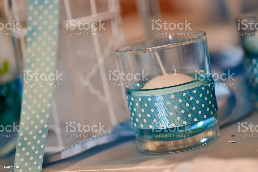 Beautiful decorative candle with blue riband stock photo