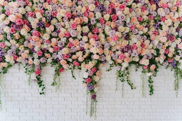 Beautiful Decorative Colorful Roses on Brick Wall stock photo