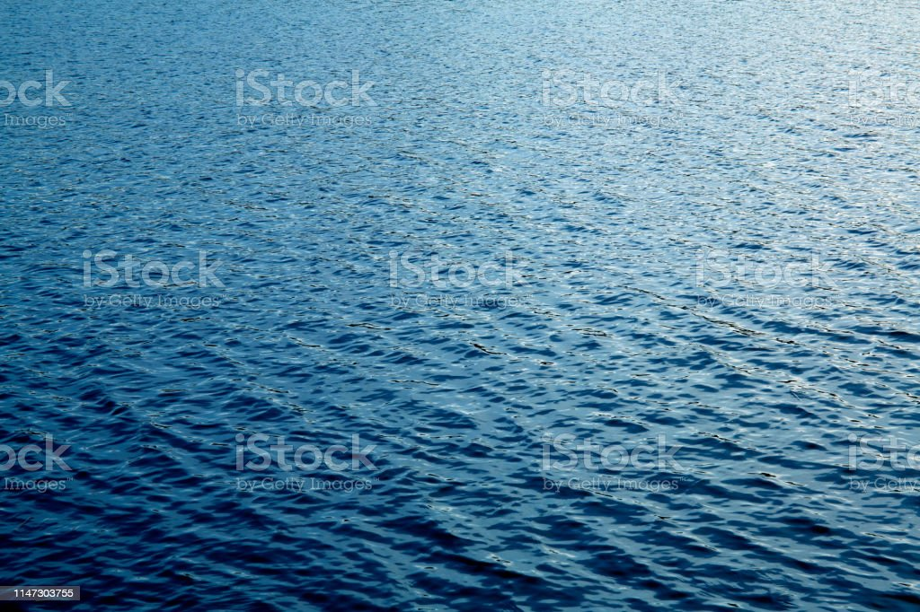 Beautiful deep blue lake water surface sun glare background texture - Royalty-free Abstract Stock Photo