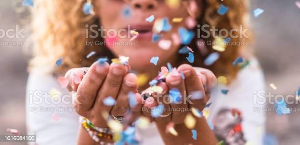 Beautiful defocused woman blow confetti from hands celebration and picture id1016084100?b=1&k=6&m=1016084100&s=612x612&h=exbuifg9fzofi0uofrerqefrlgjshul yo fsy8ly44=