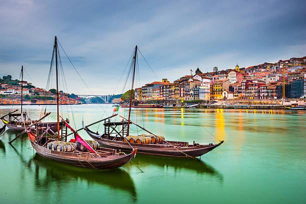 beautiful depiction of boats at porto portugal - portugal stock photos and pictures