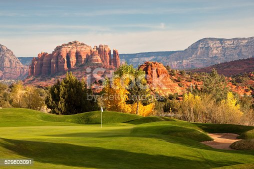A beautiful desert golf course. Sedona, Arizona, United States. The American southwest is home to some of the most spectacular golf courses in the world. This is a golf course scenic image taken in fall with the cottonwoods in beautiful yellow and gold colour.