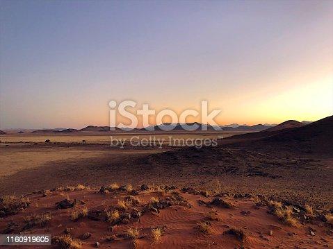 istock Beautiful Desert Sand dunes and Landscape at sunrise 1160919605