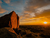 Beautiful desert sunset red rock boulder looking over Arizona desert, Scottsdale and Phoenix.