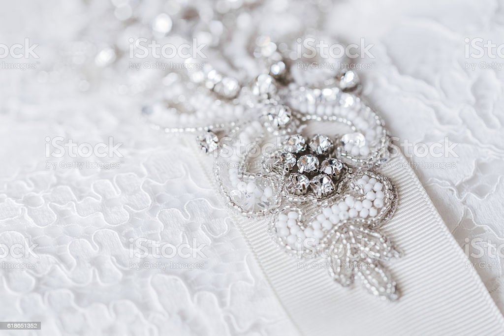 Beautiful details of a wedding dress beadwork close-up stock photo