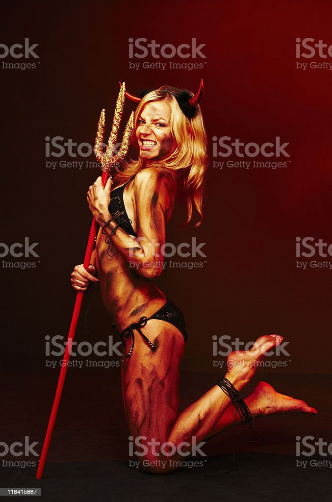 Beautiful devil with trident - Halloween stock photo