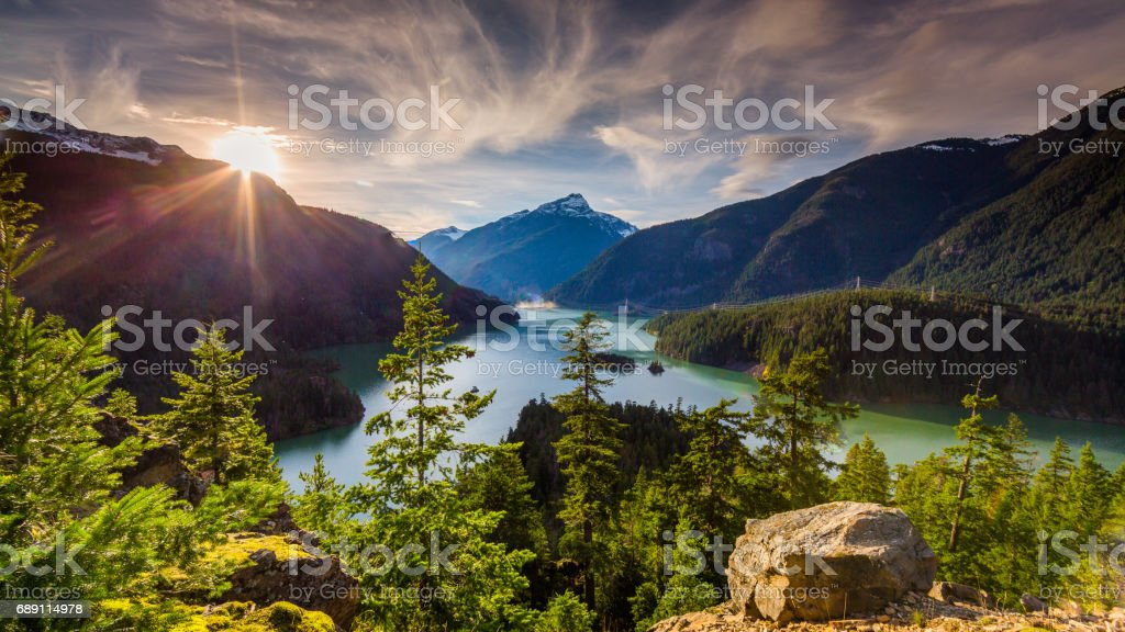 Beautiful Diablo Lake is a reservoir in the North Cascade mountains of northern Washington state, United States. stock photo