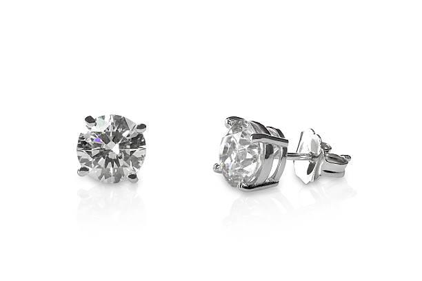 wunderschöne diamant-ohrstecker - ohrringe piercing stock-fotos und bilder
