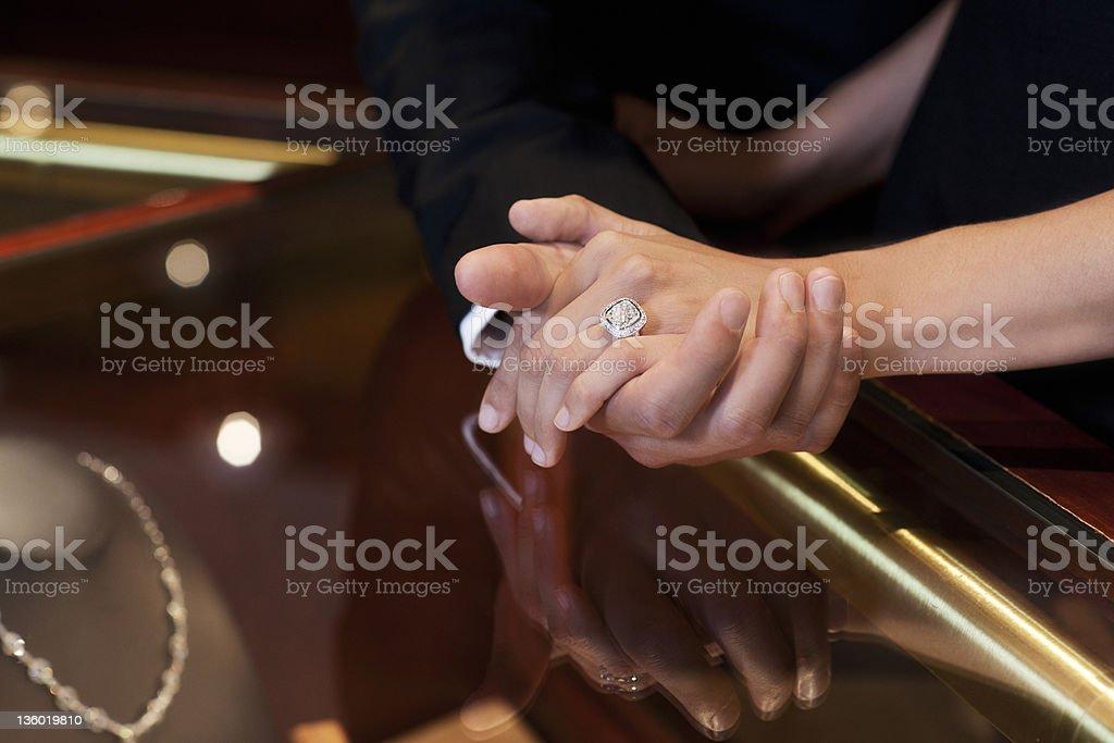 Beautiful Diamond Wedding Ring on Hand in Jewelry Store royalty-free stock photo