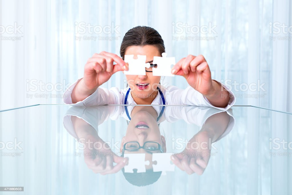 Beautiful doctor with puzzle royalty-free stock photo