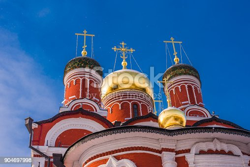 istock Beautiful dome with crosses of orthodox church in winter against a background of bright blue sky 904697998