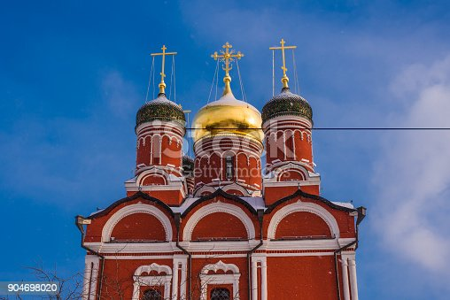 istock Beautiful dome with crosses of orthodox church in winter against a background of bright blue sky 904698020
