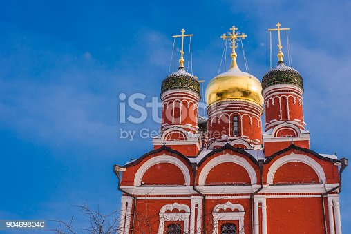 istock Beautiful dome with crosses of orthodox church in winter against a background of bright blue sky 904698040