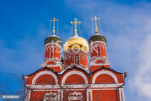 istock Beautiful dome with crosses of orthodox church in winter against a background of bright blue sky 904698064