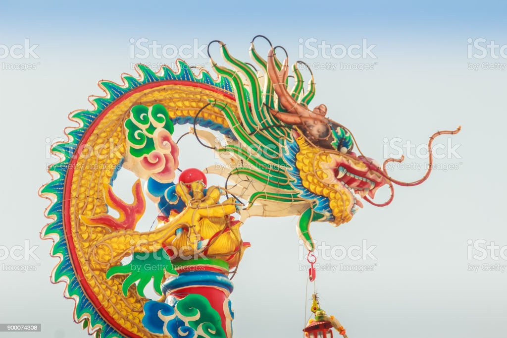 Beautiful Dragon Sculpture on the Chinese Pavilion Roof in the Chinese Temple stock photo