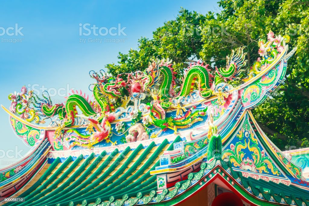 Beautiful Dragons Sculpture on the Chinese Pavilion Roof in the Chinese Temple stock photo