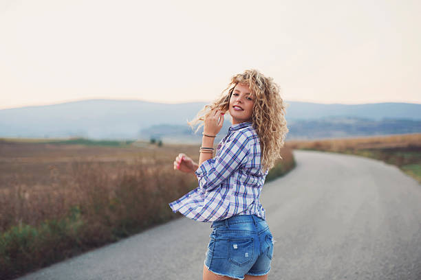 beautiful dreamer - jean shorts stock photos and pictures