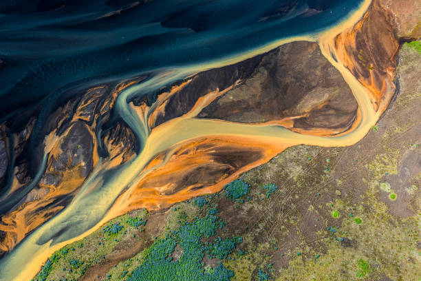 Beautiful, dream-like landscape of rural Iceland, covered with it's intersecting glacial river trails, taken from a helicopter stock photo