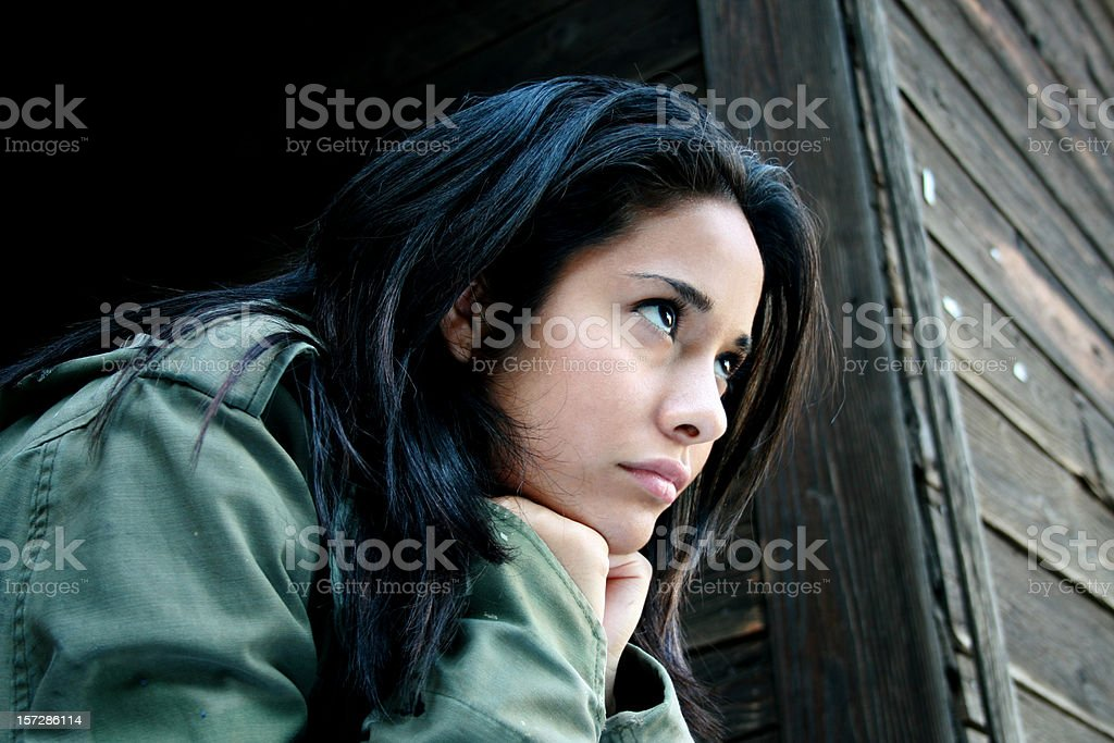 Beautiful dreary looking woman stock photo