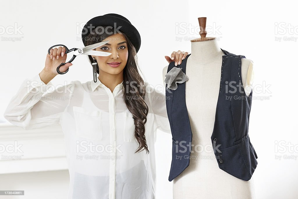 Beautiful dress designer with mannequin in fashion studio royalty-free stock photo