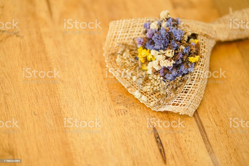 Beautiful dried flower bouquet placed on a wooden table, a bouquet of...