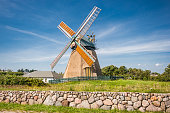 Traditional windmill in beautiful scenery with blue sky and clouds on a sunny day in summer
