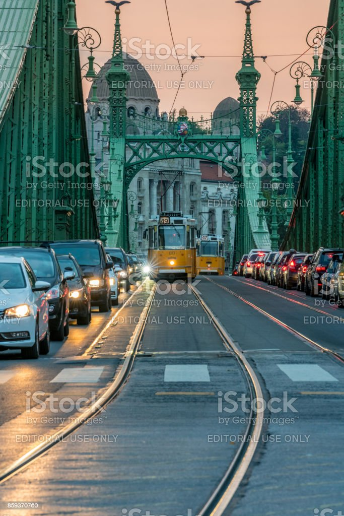 Beautiful dusk view of Liberty bridge in Budapest with waiting traffic. stock photo