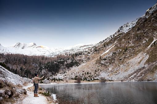 629376126 istock photo Beautiful Early Winter scenery at the Lakeshore in Julian Alps - Krnska Lake 1199429373