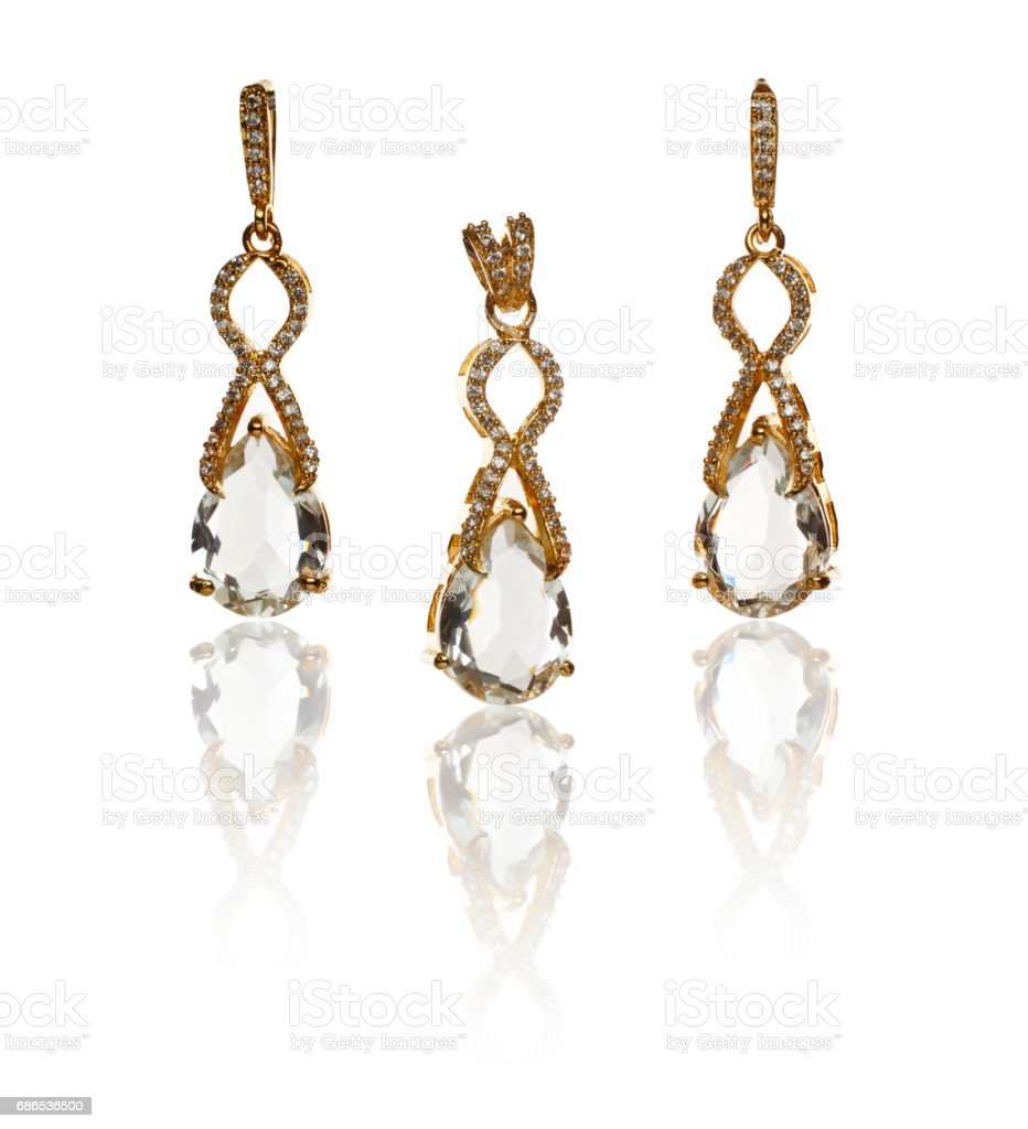 Beautiful earrings and pendal over white background foto stock royalty-free