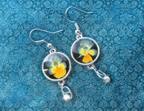 Beautiful earrings with flowers in resin. Women's jewelry, Beautiful earrings with flowers in resin. Women's jewelry, accessory. fossilized pitch stock pictures, royalty-free photos & images