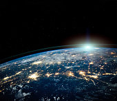 Beautiful Earth space view by night with sun on horizon with copyspace. Science background. Elements of this photo furnished by NASA. https://images-assets.nasa.gov/image/iss040e090540/iss040e090540%7eorig.jpg